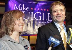 Democratic Cook County Commissioner Mike Quigley, right, celebrates with is wife Barbara, left, in Chicago on Tuesday  after winning the Democratic primary for the 5th Congressional seat.