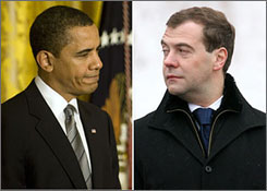 President Obama has denied that he suggested to Russian President Dmitry Medvedev, right, that the United States might back off from plans for military defense in Eastern Europe in exchange for help preventing Iranian arms buildup.