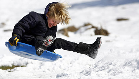 Ian Baldwin, 11, careens down a hill while sledding Tuesday in Jackson, Tenn.