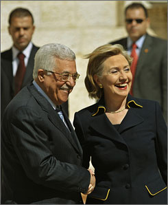 Secretary of State Hillary Rodham Clinton shakes hands with Palestinian President Mahmoud Abbas Wednesday as she is welcomed at Abbas' headquarters in Ramallah, West Bank.
