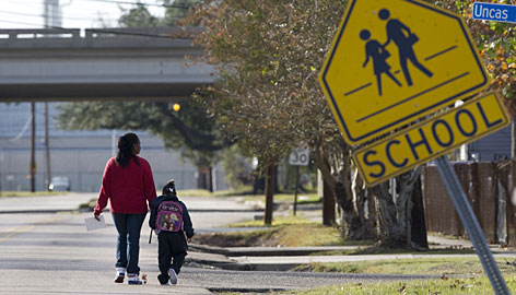 Darlene Patterson walks her granddaughter, Deondra Scott, 4, by Wyandotte Early Childhood Center, near an ExxonMobile refinery, in Baton Rouge on Dec. 5. The state says samples show no toxic threat in the air outside the center.