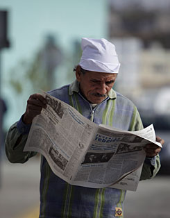 A man reads Juventud Rebelde on a street in Havana on Thursday. Two of Cuba's most prominent officials have resigned from all Communist Party and government posts after they were removed from the Cabinet and criticized by Fidel Castro, according to letters published Thursday in the state press.