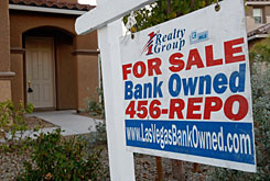 A sign hangs outside of a foreclosed home on Nov. 13 in North Las Vegas, Nevada. A USA TODAY analysis of a report by RealtyTrac shows most of the 35 counties leading the foreclosure boom are clustered in places such as Southern California, Las Vegas, Phoenix, South Florida and Washington, where home values shot up dramatically in the first half of the decade, then began to crumble.