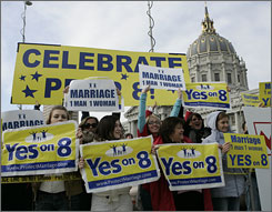 Same-sex marriage protestors rally Thursday in front of San Francisco's City Hall, the same day the state high court heard arguments on Proposition 8, the initiative that made gay marriage illegal.