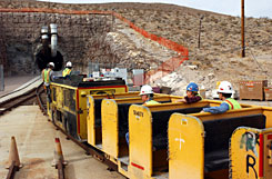 Mine workers board the train to take them into the South Tunnel at Yucca Mountain in Nevada. In the past two months, President Obama has put on hold some of George Bush's environmental plans, and Obama's budget does not fund the Energy Department's plan to store nuclear waste at Yucca Mountain.