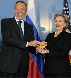 Russia Foreign Minister Sergei Lavrov, left, smiles while pressing a red knob with Secretary of State Hillary Clinton during a bilateral meeting in Geneva on Friday. The meeting produced no announced breakthrough in arms control or other issues, but it seemed to set the stage for a new beginning in U.S.-Russian relations.