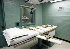 A microphone hangs over a gurney in the Texas death house in Huntsville last May. In hard economic times, more states say it costs more to execute killers than to imprison them for life.