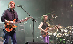Vocalist Trey Anastasio, left, bassist Mike Gordon, center, and drummer Jon Fishman, right, of Phish perform for the first time in five years at the Hampton Coliseum in Hampton, Va., Friday.  This was the first of three concerts by the reunited group.