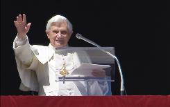 """Pope Benedict XVI says his Sunday Angelus prayer from his window at the Vatican. The pontiff said he will visit the Holy Land in May to pray for """"unity and peace for the Middle East."""""""