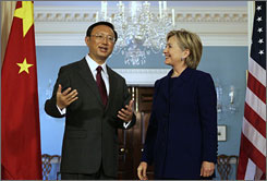 Secretary of State Clinton, right, met with Yang Jiechi, the Chinese foreign minister, although neither made public statements over a recent confrontation in the South China Sea.