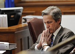 Former Republican senator Norm Coleman waits for the Senate vote recount trial to start in St. Paul, on Feb. 26.