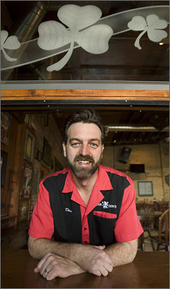 Dave Morris, owner of Piper Down, poses at his members-only bar in Utah in February. The Legislature eliminated the state's private club system, which requires customers to fill out an application and pay a fee for the right to enter a bar.