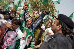 PML supporters confront police outside of Pakistani opposition leader Nawaz Sharif's residence.