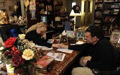 Psychic Valerie Morrison gives a reading to client Armond Demarzio on Friday in her office in Philadelphia. Psychics are seeing more business thanks to the economic downturn. Morrison says she is seeing more clients and that many are interested in talking about business. The topics of love and health are secondary.