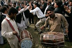 Lawyers dance as they celebrate the government's announcement to reinstate Iftikhar Chaudhry as chief justice in Peshawar.