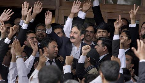 Reinstated judge Ifikhar Chaundry is greeted by lawyers after the announcement was made Monday in Islamabad, Pakistan.