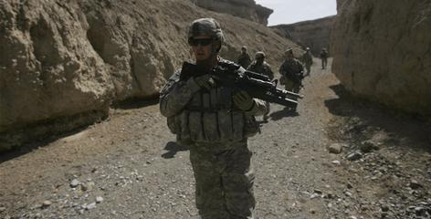 Members of the 101st Airborne Division patrol in the outskirts of Bagram, north of Kabul, Afghanistan.