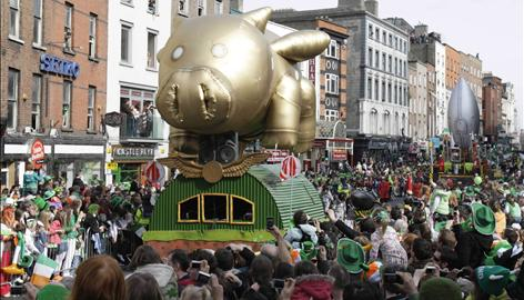 The  St. Patrick's Day parade moves  through the center of Dublin Tuesday as an estimated 500,000 people celebrate.