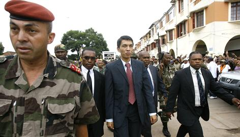 Opposition leader Andry Rajoelina walks to a support rally in Antananarivo, Madagascar. The president announced Tuesday he handed over power, not to the rival, to the military.