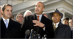 Mayor Ray Nagin, center, speaks to the news media last month after meeting with President Obama in Washington.