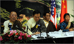 Shingsta Tenzinchodrak, left, speaks Tuesday at a news conference at the Chinese Embassy in Washington. Tenzinchodrak headed a Tibetan delegation of legislators that included, from left, a man identified only as Mr. Ngawang, Karma Rinchen and Kelsand Drolkar.