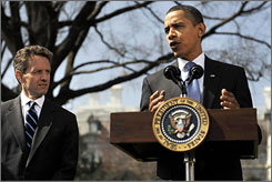 President Obama stands with Treasury Secretary Timothy Geithner as he makes remarks about AIG and his economic recovery package before departing for a trip to California on Wednesday.