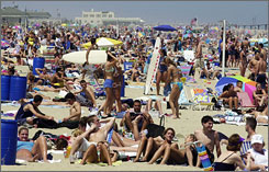 Beachgoers enjoy the sun in Belmar, N.J., a state where Brazilian bikini waxing may be banned as early as next month.