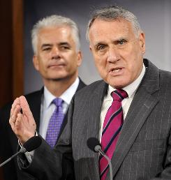 Sen. Jon Kyl, right, blocked Democratic efforts Thursday evening to bring up the Senate version of the tax bill to recoup most of the $165 million paid out by AIG last weekend.