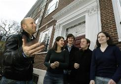 Greg Epstein, left, the humanist chaplain at Harvard University, laughs with students after a group meeting on campus in Cambridge, Mass., March 6. Harvard sophomores, from left, are Kelly Bodwin, Lewis Ward, Andrew Maher and Greta Friar. Epstein envisions local humanist centers nationwide that perform many of the community-building functions of a church, only in service of the humanist creed, which he sums up as a commitment to living ethical, personally fulfilling lives while serving the greater good.