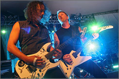 Metallica's Kirk Hammell, left, and James Hetfield perform at the SXSW Music Festival in Austin on Friday.