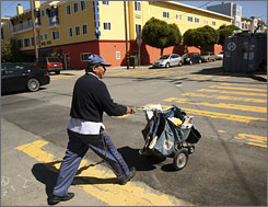 A mail carrier who identified himself as Manuel makes his rounds in the Cow Hollow neighborhood in San Francisco on Friday. The U.S. Postal Service said on Friday it is closing six of its 80 district offices. Also, administrative staff positions at the district level are being reduced by 15 percent and nearly 150,000 employees are being given the opportunity to take an early retirement.