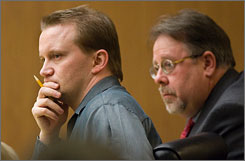 "Dale Hausner, left, and his attorney, Tim Agan, listen to testimony from alleged fellow ""Serial Shooter"" Sam Dieteman, in Maricopa County Superior Courtroom in Phoenix, Jan. 6."