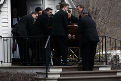 Actor Liam Neeson, left, and pallbearers on Sunday carry the casket of actress Natasha Richardson to St. Peter's Episcopal Church, in Lithgow, N.Y.