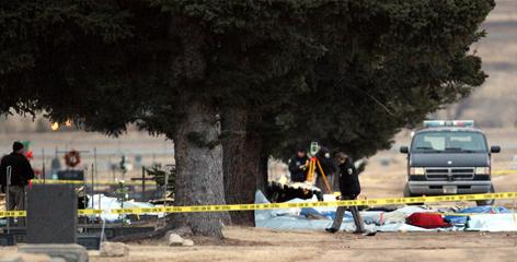 NTSB investigators, local police and members of the sheriff department investigate the scene of fatal plane crash outside the Butte Airport in Butte, Mont.
