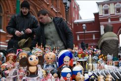 A street vendor sells souvenir dolls, including some with the portrait of then-president Vladimir Putin, in downtown Moscow on Nov. 15, 2007.