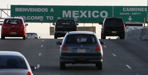Southbound vehicles cross from El Paso into Ciudad Juarez, Mexico, last year. The U.S. announced plans Tuesday to step up searches for smuggled drugs, weapons and money, as Mexico's spiraling drug war seeps across the border.