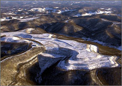 The EPA has put a temporary hold on permits for mountaintop coal mining so it can review the process. Here, mountain peaks flattened by mountaintop coal mining in Kayford, W. Va., are shown.