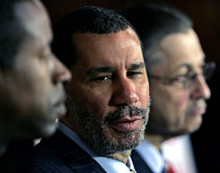 N.Y. Gov. David Paterson speaks during a news conference at the Capitol in Albany, N.Y., Monday. Senate Majority Leader Malcolm, D-Queens, left, and Assembly Speaker Sheldon Silver, D-Manhattan, listen.