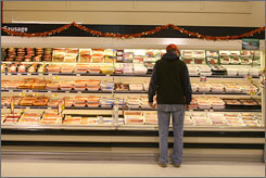 A new study shows that people who eat red meat daily increase their mortality risk. Here, a man looks over packaged meat at a grocery store in Herndon, Va.