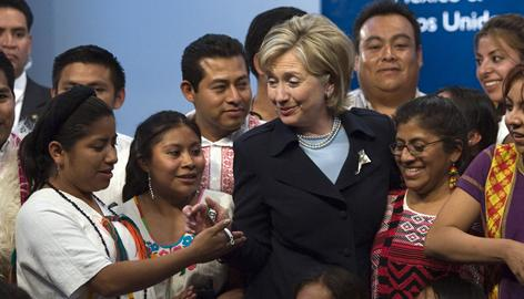 Secretary of State Hillary Rodham Clinton receives a gift from indigenous students Wednesday during an event in support of indigenous education in Mexico City. 