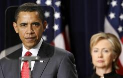 President Obama announces a new strategy for Afghanistan and Pakistan in Washington Friday as Secretary of State Hillary Clinton stands behind him.