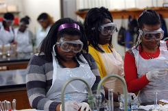 Students run through experiments in chemistry lab at LeMoyne-Owen College in Memphis, Tenn. All the students in this lab at the co-ed college were female. The proportion of women at historically black colleges has continued gradually rising, from 53% in 1976 to about 61% the last few years.