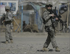 U.S. soldiers stand guard near the site of an explosion in the outskirts of Kabul, Afghanistan on March 15.