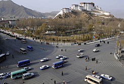 Vehicles pass a crossroad in Lhasa, capital of southwest China's Tibet Autonomous Region. China plans to reopen Tibet to foreign tourists on April 5, state media reported, in a sign of the regime's growing confidence following the passage of several sensitive anniversaries without apparent major disturbances.