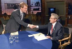 Congressional candidates Scott Murphy, left, and Jim Tedisco prepare to debate at the studios of television station WNYT in Menands, N.Y., on March 24.