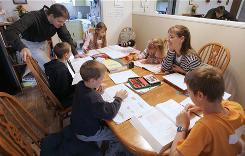 Uwe Romeike and his wife Hannelore work with their children at home in Morristown, Tenn., where they moved from Germany, where school attendance is compulsory and homeschooling forbidden.