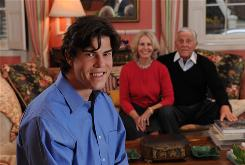 Quinn Bradlee, son of retired Washington Post editor Ben Bradlee and journalist Sally Quinn, behind him, has written a memoir titled A Different Life: Growing up Learning Disabled and other Adventures. The 26-year-old has VCFS, a genetic disorder.