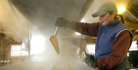 Ann Comeau makes maple syrup at the sugarhouse she and her husband run in Williston, Vt.
