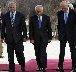 Incoming Israeli Prime Minister Benjamin Netanyahu, left, President Shimon Peres, center, and outgoing Prime Minister Ehud Olmert attend a change of power ceremony at Peres' residence Wednesday in Jerusalem.