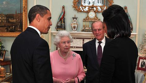 The president and first lady talk with Britain's Queen Elizabeth II and Prince Phillip duing an audience at Buckingham Palace on Wednesday in London.